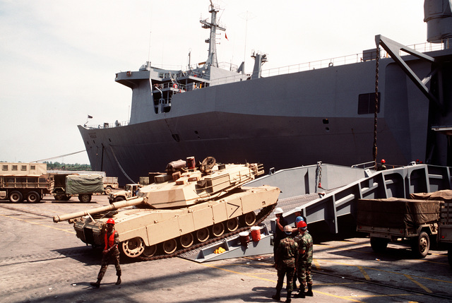 A U.S. Army M-1 Abrams main battle tank is loaded aboard the rapid-response vehicle cargo ship USNS REGULUS (T-AKR-292). The REGULUS is transporting equipment to Saudi Arabia in support of Operation Desert Shield