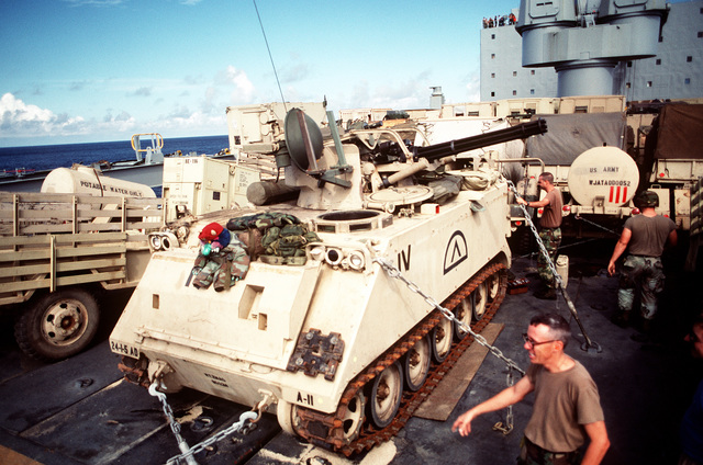 A U.S. Army M-163 Vulcan self-propelled anti-aircraft gun is secured aboard the rapid-response vehicle cargo ship USNS REGULUS (T-AKR-292). The gun, along with other equipment, is being transported to Saudi Arabia in support of Operation Desert Shield