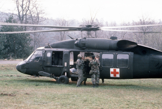 A simulated casualty is loaded into a UH-60A Black Hawk (Blackhawk) helicopter by personnel of the 763rd Hospital during Operation CROCODILE, a training exercise for medical, decontamination and chemical reaction team personnel
