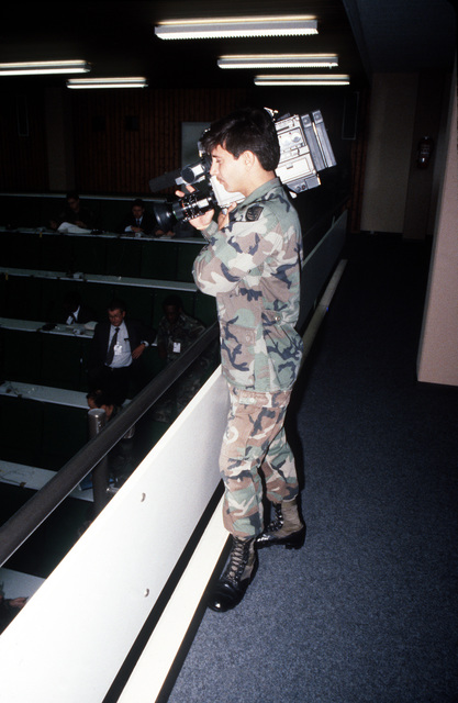 An Army video cameraman films a planning conference for Operation CROCODILE, a training exercise for medical, decontamination and chemical reaction team personnel
