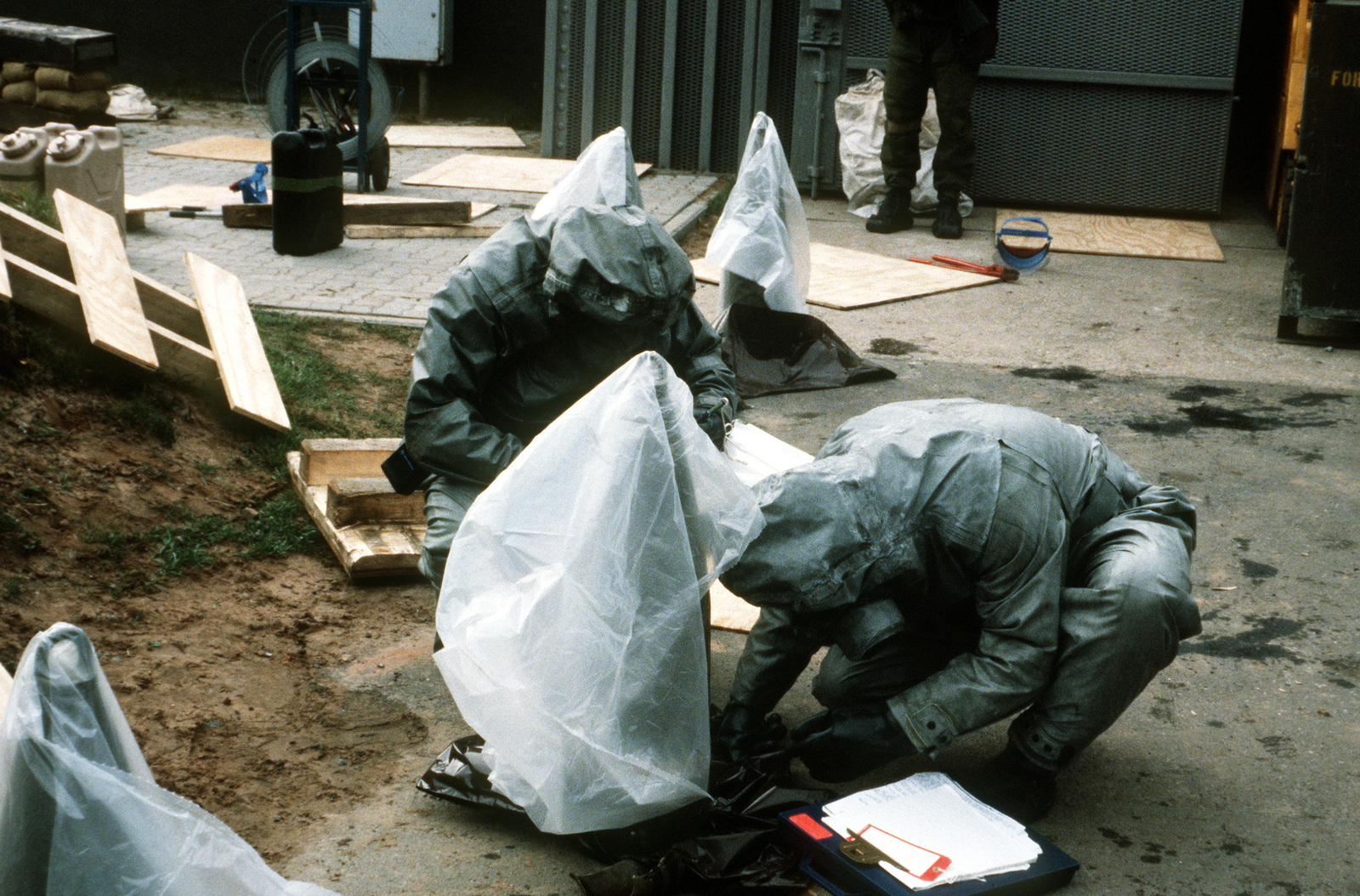 Soldiers wearing nuclear-biological-chemical (NBC) protective suits