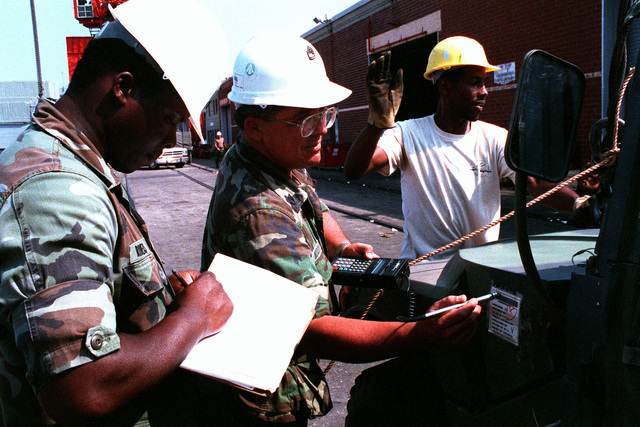 SGT. 1ST Class Moody and SPEC. Rivers take bar code readings while conducting an inventory of equipment bound for the Middle East in support of Operation Desert Shield