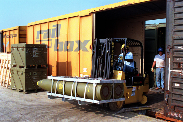 A workman uses a forklift to move a pallet of Mark 84 2,000-lb. bombs, part of an ordnance shipment bound for the Middle East in support of Operation Desert Shield
