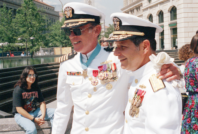 CAPT Thomas G. Kelley poses for a photograph with VADM Jeremy Michael Boorda, chief of naval personnel, deputy chief of naval operations (manpower, personnel and training), during the Captain's retirement ceremony at the U.S. Naval Memorial. During his distinguished naval career, Kelley received numerous awards, including the Medal of Honor for conspicuous gallantry while serving in Vietnam