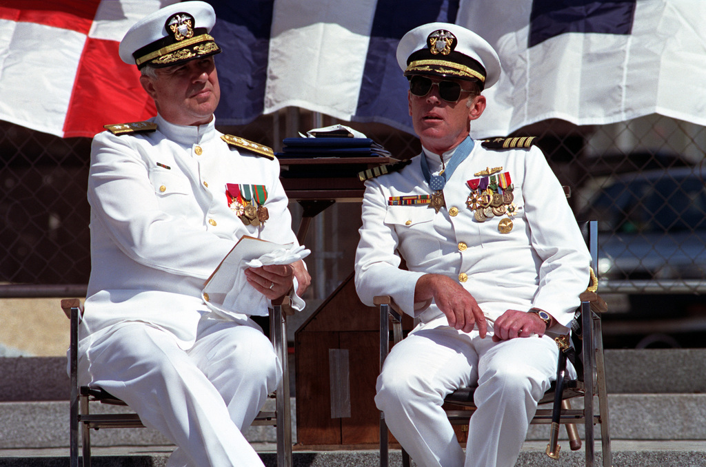 Rear Admiral Alvin B. Koeneman, CHIEF of Chaplains/Director of Religious Ministeries, sits beside Captain Thomas G. Kelley during the captain's retirement ceremony at the United States Navy Memorial. During his distinguished naval career, Kelley received numerous awards, including the Medal of Honor for conspicuous gallantry while serving in Vietnam