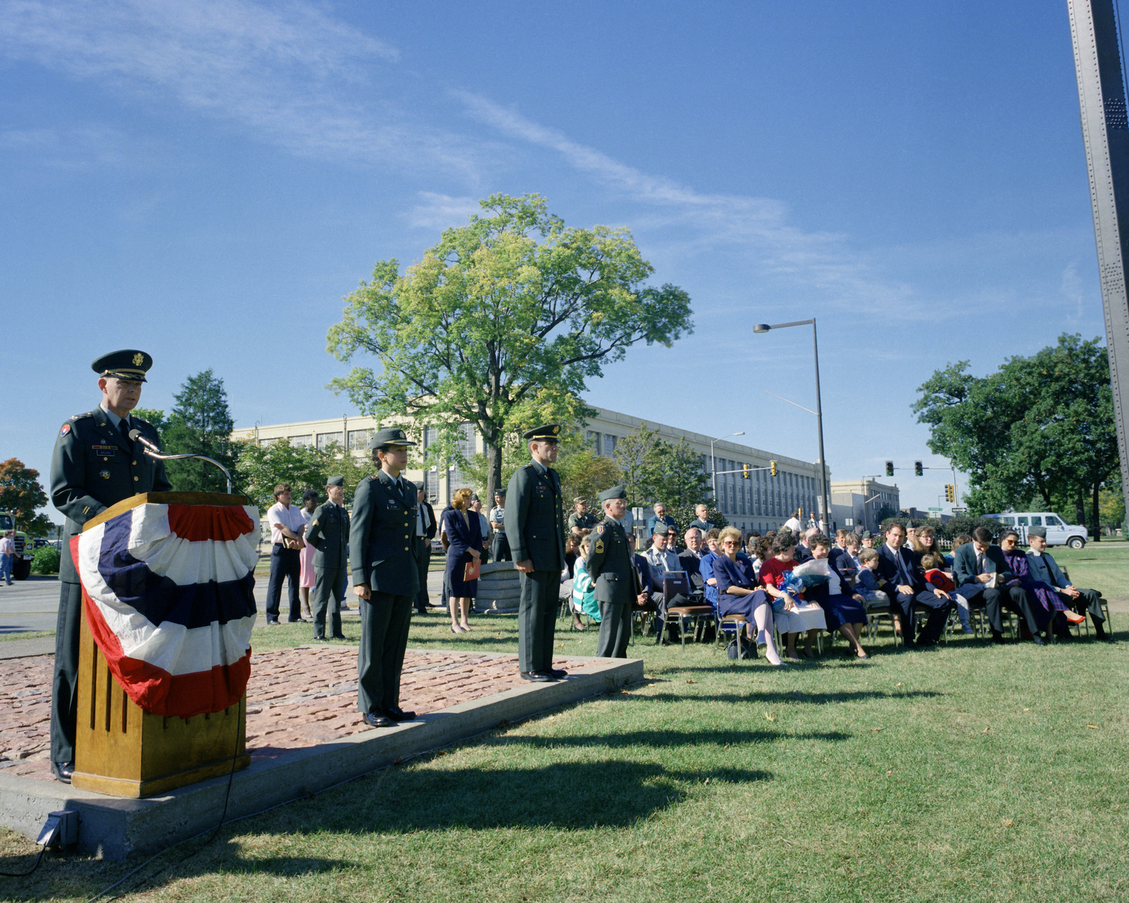 COL Richard W. Bregard, the new commanding officer of the arsenal, speaks during the ceremony at which he assumes command. Standing by are CPT St. John and CPT Gneimi