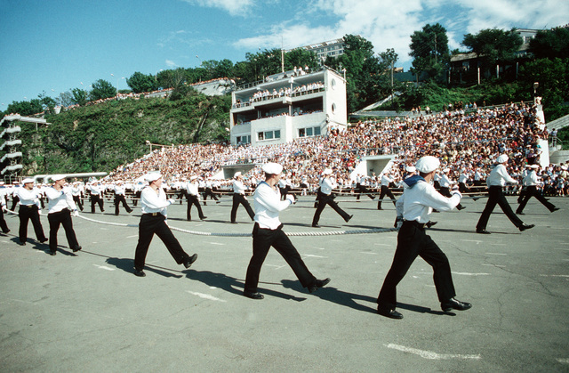 Soviet sailors perform a drill routine during a military review held for Soviet citizens and visiting American sailors. The guided missile cruiser USS PRINCETON (CG 59) and the guided missile frigate USS REUBEN JAMES (FFG 57) are visiting Vladivostock as part of a United States/Soviet goodwill exchange program
