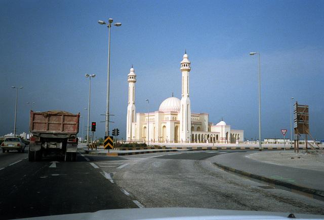 Civilian vehicles wait at a traffic light near a mosque during Operation Desert Storm.