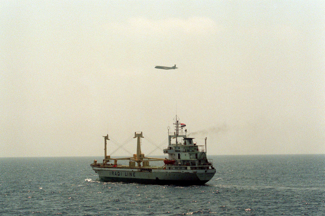 A port quarter view of the Iraqi general dry cargo ship ZANOOBIA underway, with a British Bae Nimrod aircraft flying overhead. The aircraft is conducting surveillance missions in the gulf during Operation Desert Shield