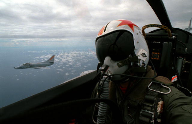 A close-up view of the photographer in a Fleet Composite Squadron 5 (VC-5) TA-4J Skyhawk aircraft with a VC-5 A-4E Skyhawk aircraft flying off the right side during exercise THALAY THAI '89