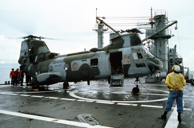 A Marine Medium Helicopter Squadron 162 (HMM 162) idles on the flight deck of the tank landing ship USS BARNSTABLE COUNTY (LST 1197) before departing for Freetown, Sierra Leone, with a load of civilian evacuees from Liberia. The BARNSTABLE COUNTY is among the ships on station off the coast of Liberian for Operation SHARP EDGE