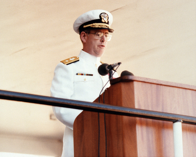 RADM (lower half) John T. Hood, program manager, Aegis Shipbuilding Project, speaks during the launch of the guided missile cruiser SHILOH (CG-67) at the Bath Iron Works Corp. shipyard