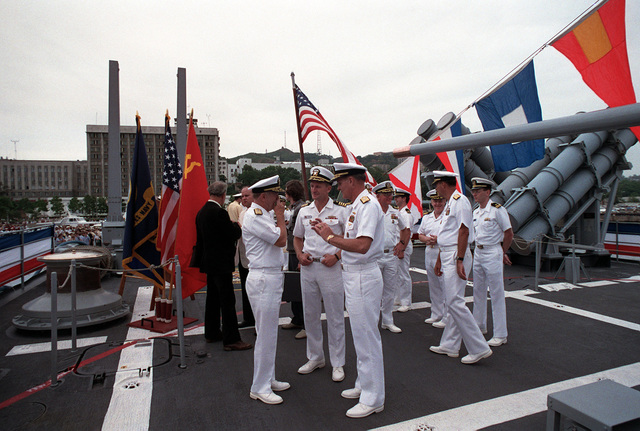 Admiral Charles R. Larson, center, Commander in CHIEF, US Pacific Fleet, gestures as he speaks with two other senior officers aboard the guided missile cruiser USS PRINCETON (CG 59). The PRINCETON and the guided missile frigate USS REUBEN JAMES (FFG 57) have come to Vladivostok for a four-day goodwill visit