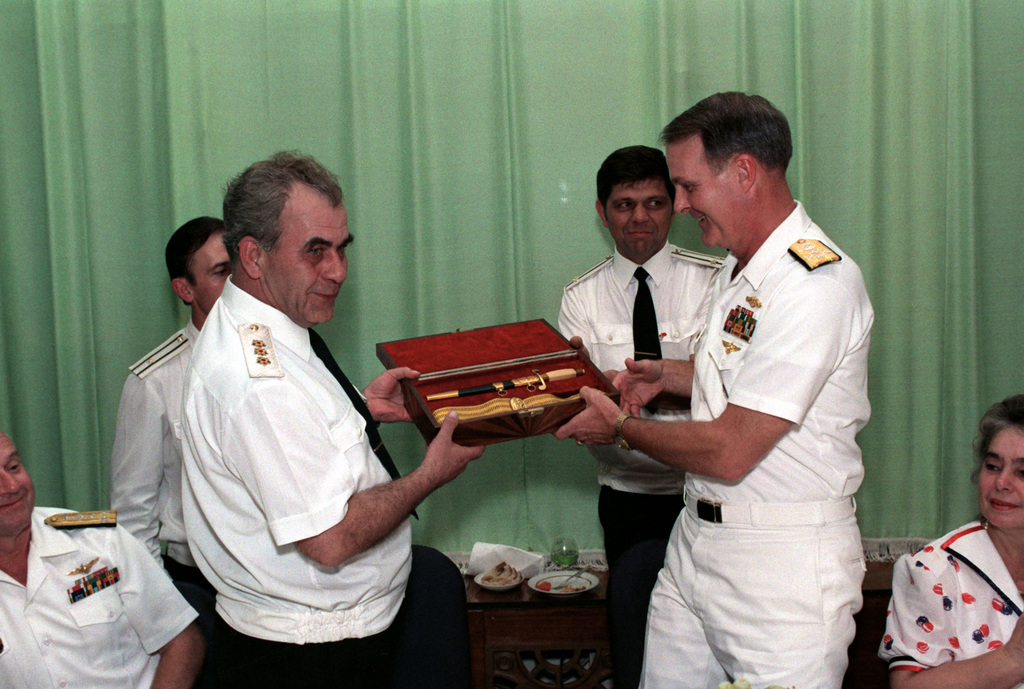 Admiral Charles R. Larson, Commander in CHIEF, US Pacific Fleet, accepts a ceremonial dagger as a gift from Admiral Gennadi Khvatov, Commander, Soviet Pacific Fleet, at a reception held during a visit to the city by two US Navy ships. The guided missile cruiser USS PRINCETON (CG-59) and the guided missile frigate USS REUBEN JAMES (FFG 57) are in Vladivostok for four days as part of a goodwill exchange program