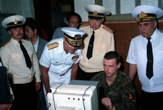 Admiral Charles R. Larson, Commander in CHIEF, US Pacific Fleet, watches a Soviet naval infantryman working on a computer at a Soviet navy service school during a visit to the city by two US Navy ships. The guided missile cruiser USS PRINCETON (CG-59) and the guided missile frigate USS REUBEN JAMES (FFG 57) are in Vladivostok for four days as part of a goodwill exchange program. Admiral Gennadi Khvatov, Commander, Soviet Pacific Fleet, is at right