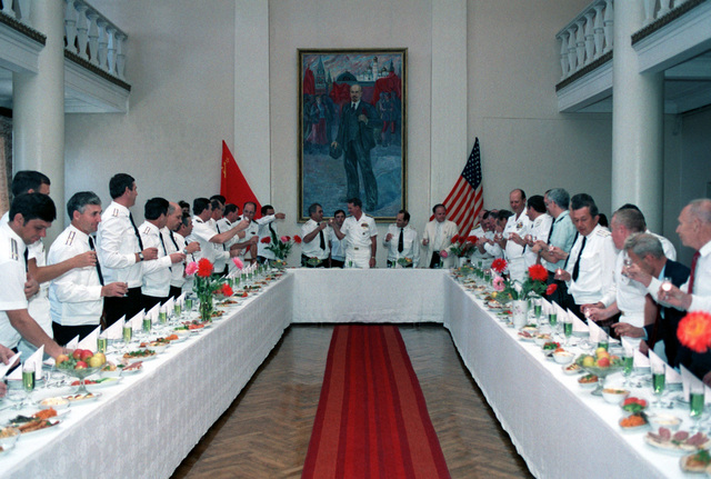 Standing at the head table, Admiral Gennadi Khvatov, Commander, Soviet Pacific Fleet, and Admiral Charles R. Larson, Commander in CHIEF, US Pacific Fleet touch glasses after making a toast at a luncheon held during a visit to the city by two US Navy ships. The guided missile cruiser USS PRINCETON (CG-59) and the guided missile frigate USS REUBEN JAMES (FFG 57) are in Vladivostok for four days as part of a goodwill exchange program