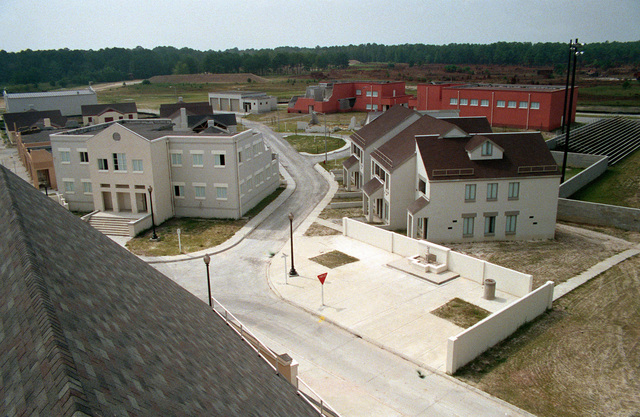 A view, looking southwest from the church steeple, of the combat village at the Military Operations in Urban Terrain (MOUT) Collective Training Facility