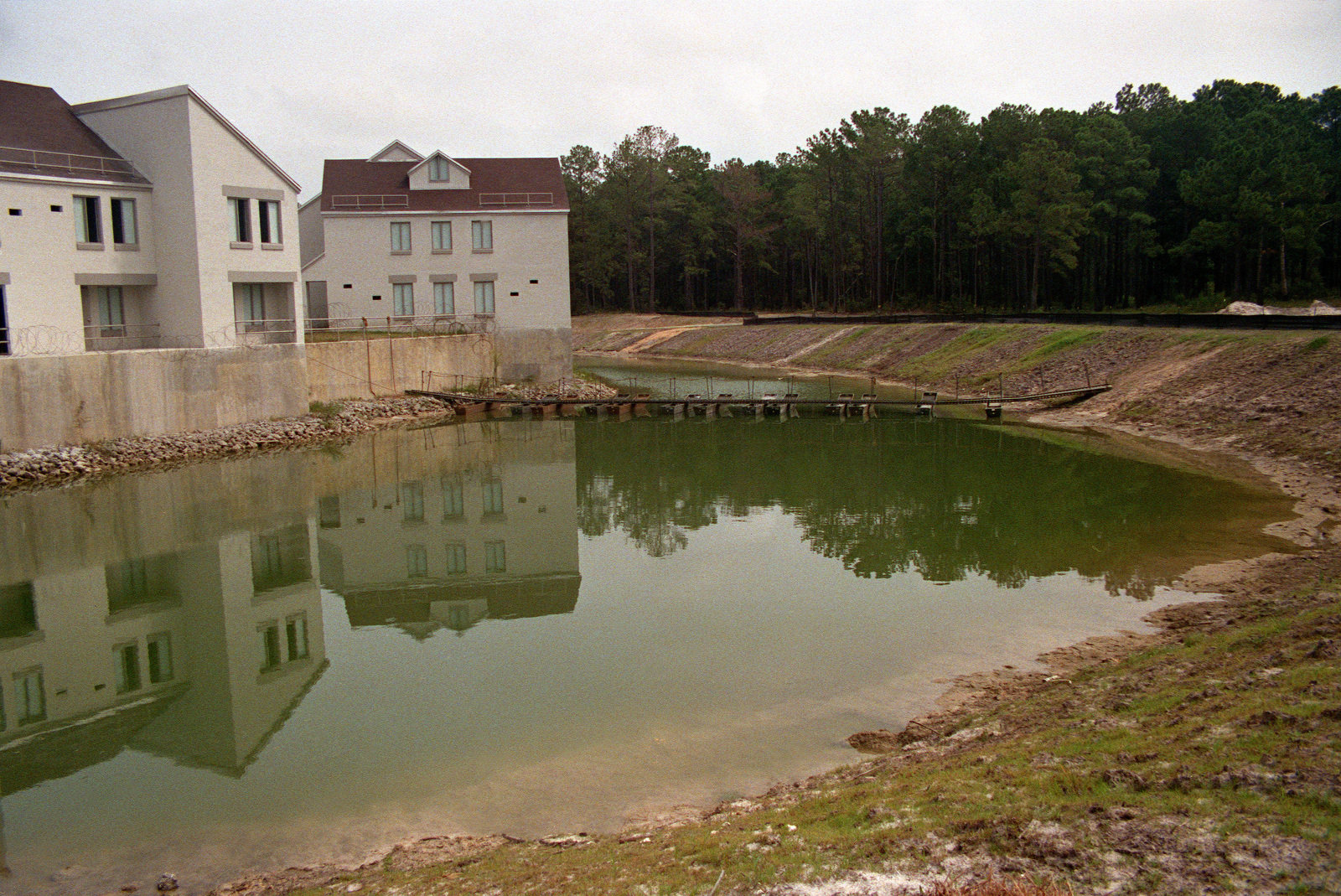 A View Of A Moat And Townhouses On The Eastern Edge Of The Combat