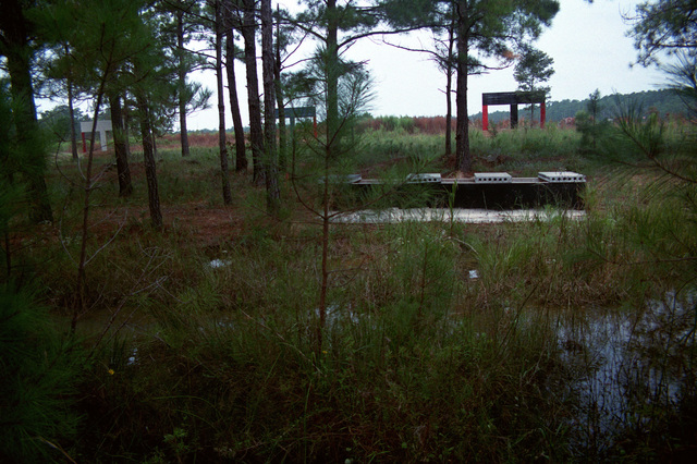"A view of ""The Sewer,"" on the obstacle course at the Military Operations in Urban Terrain (MOUT) Collective Training Facility. The frame structures in the background contain pop-up targets"