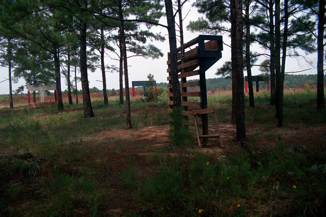 "A view of ""The Wall,"" on the obstacle course at the Military Operations in Urban Terrain (MOUT) Collective Training Facility. The frame structures in the background contain pop-up targets"