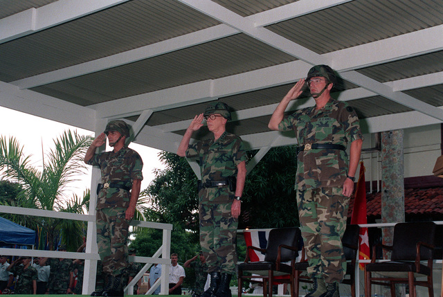 Brig. GEN. Joseph W. Kinzer, left, GEN. Maxwell R. Thurman, center, commander in chief, U.S. Southern Command (SOUTHCOM), and Barig. GEN. William W. Hartzog salute the colors during a change of command ceremony. Hartzog is relieving Kinzer as commanding general of Fort Clayton
