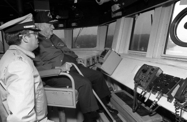 Retired Admiral Arleigh A. Burke, namesake of the guided missile destroyer ARLEIGH BURKE (DDG 51), and an officer look out from the bridge during the ship's sea trials off the coast of Maine. The ARLEIGH BURKE is one of the few ships that has ever been named for a living person