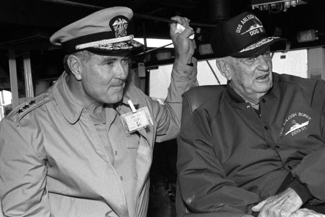 Vice Admiral Joseph S. Donnell III, Commander, Naval Surface Force, United States Atlantic Fleet, and retired Admiral Arleigh A. Burke, namesake of the guided missile destroyer ARLEIGH BURKE (DDG 51), look out from the bridge during the ship's sea trials off the coast of Maine. The ARLEIGH BURKE is one of the few ships that has ever been named for a living person