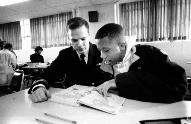 "Lieutenant Gus M. Ventura, Naval Military Personnel Command, tutors an inner city minority student in the ""Navy Kids"" program"