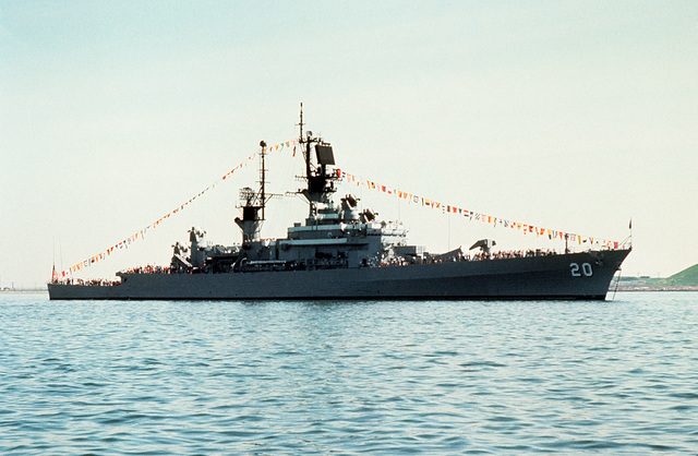 A starboard view of the guided missile cruiser USS RICHMOND K. TURNER (CG-20) at anchor in the harbor. The ship is in Boston as part of Operation Sail to take part in the city's 350th anniversary
