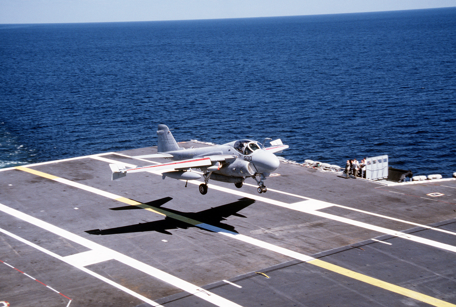"""An Attack Squadron 95 (VA-95) A-6E Intruder aircraft comes in for a landing on the flight deck of the nuclear-powered aircraft carrier USS ABRAHAM LINCOLN (CVN-72). The aircraft, piloted by air wing commander CAPT. """"Spider"""" Webb, is the first plane of Carrier Air Wing II (CVW-11) to land aboard the ship"""