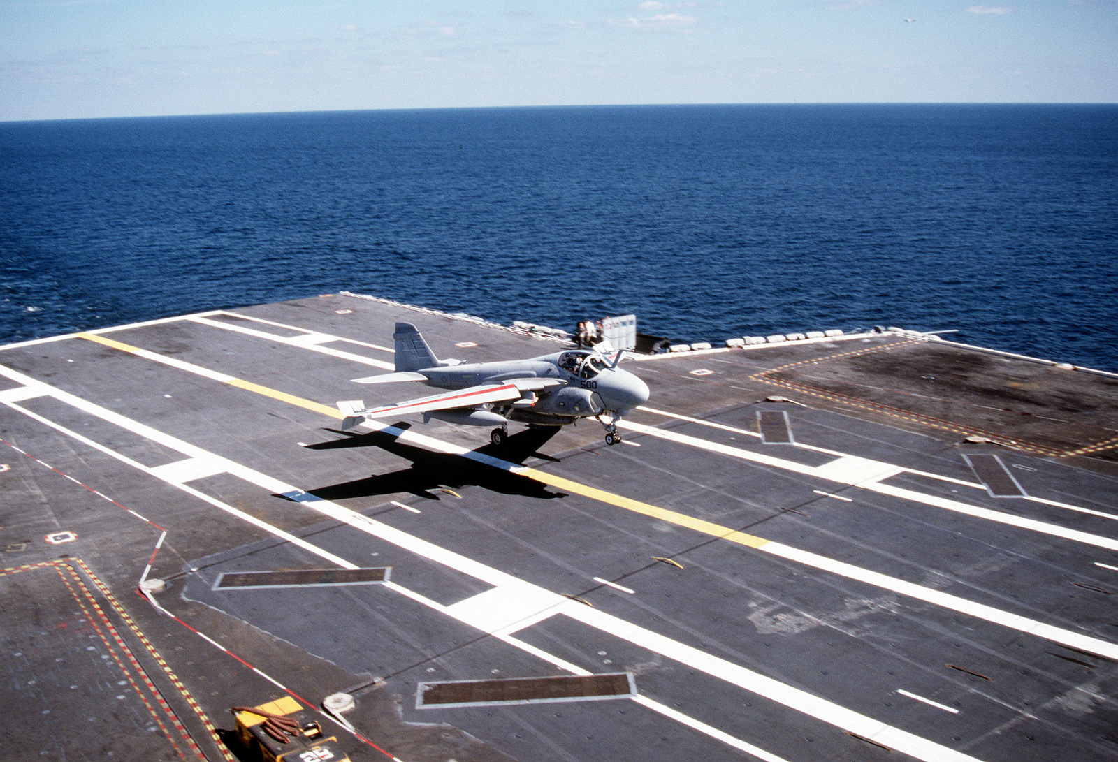 "An Attack Squadron 95 (VA-95) A-6E Intruder aircraft lands on the flight deck of the nuclear-powered aircraft carrier USS ABRAHAM LINCOLN (CVN-72). The aircraft, piloted by air wing commander CAPT. ""Spider"" Webb, is the first plane of Carrier Air Wing II (CVW-11) to land aboard the ship"