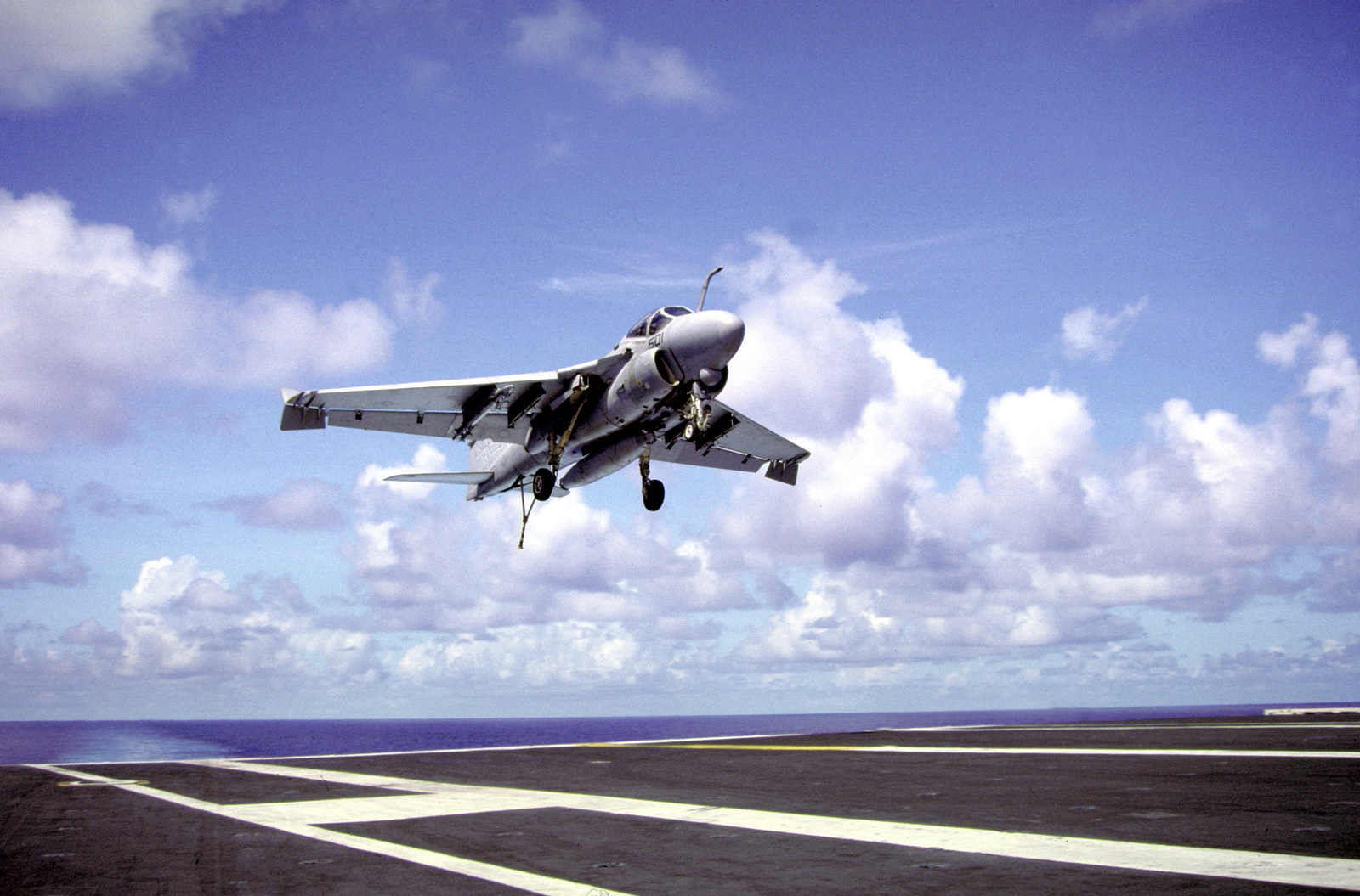 An Attack Squadron 95 (VA-95) A-6E Intruder aircraft comes in for a landing on the flight deck of the nuclear-powered aircraft carrier USS ABRAHAM LINCOLN (CVN-72)