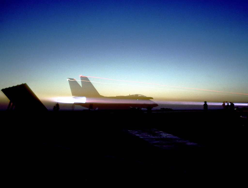 A Fighter Squadron 33 (VF-33) F-14A Tomcat aircraft is launched for a nighttime combat air patrol (CAP) from the flight deck of the aircraft carrier USS AMERICA (CV 66).