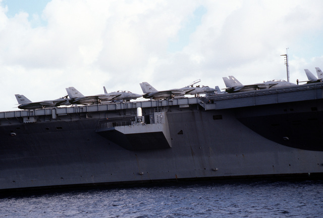 F-14A Tomcat aircraft from Figher Squadron 114 (VF-114) and Fighter Squadron 213 (VF-213) are parked on the flight deck of the nuclear-powered aircraft carrier USS ABRAHAM LINCOLN (CVN-72) above one of the LINCOLN's Mark 16 Phalanx close-in weapon systems (CIWS). The LINCOLN is making a four-day visit to the island of Saint Thomas