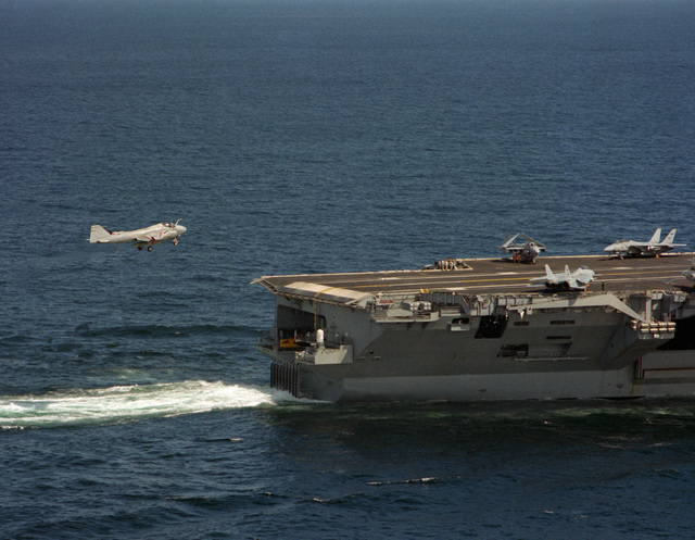 An Attack Squadron 95 (VA-95) A-6E Intruder aircraft prepares to catch the arresting wire on a flight deck of the nuclear-powered aircraft carrier USS ABRAHAM LINCOLN (CVN-72) as the vessel is underway during its circumnavigation of South America