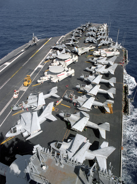 Various aircraft line the flight deck of the nuclear-powered aircraft carrier USS ABRAHAM LINCOLN (CVN-72) as the vessel is underway on its circumnavigation of South America