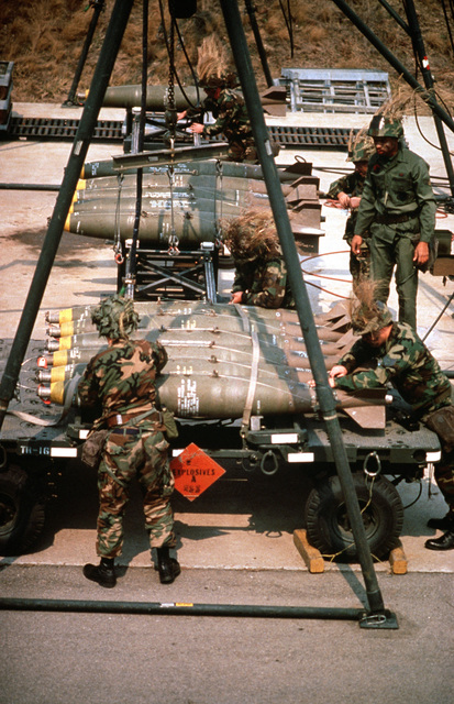 Airmen of the 6151st Consolidated Aircraft Maintenance Squadron (6151st CAMS) load Mark 82 500-pound bombs onto a trailer during the joint South KOREAn/United States exercise TEAM SPIRIT '89