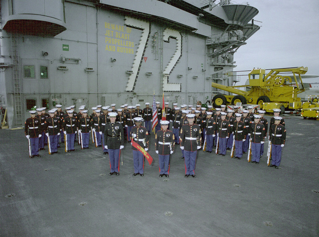 The Marine detachment aboard the nuclear-powered aircraft carrier USS ABRAHAM LINCOLN (CVN-72) stands in formation as the vessel arrives in Rio de Janeiro. The carrier is making a port call as part of its circumnavigation of South America