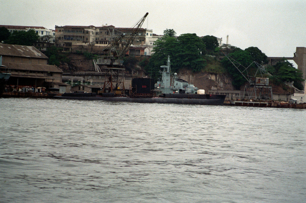 A starboard quarter view of the Brazilian diesel-powered submarine RIACHUELO (S-22) tied up at the submarine piers on the west wall of the naval base