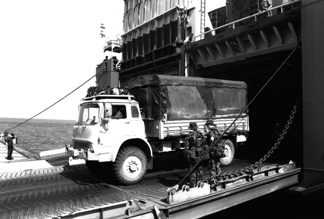 A Bedford MK 4x4 truck assigned to the British army's 7th Armour Brigade is driven down the stern ramp of the Danish cargo ship Dana Cimbria upon its arrival at the King Abdul Aziz Naval Port during Operation Desert Shield.