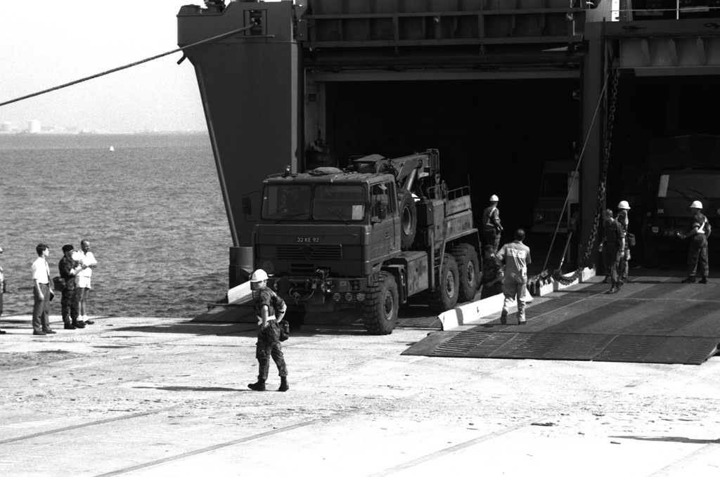 A Foden 6x6 recovery vehicle assigned to the British army's 7th Armour Brigade is driven down the stern ramp of the Danish cargo ship Dana Cimbria after its arrival at the King Abdul Aziz Naval Port during Operation Desert Storm.