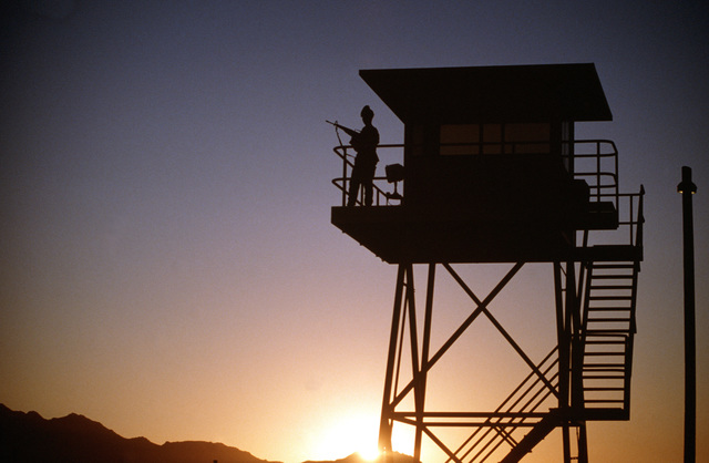 A1C T'Lisa Strong stands watch at dawn at the North American Aerospace Defense Command guard tower