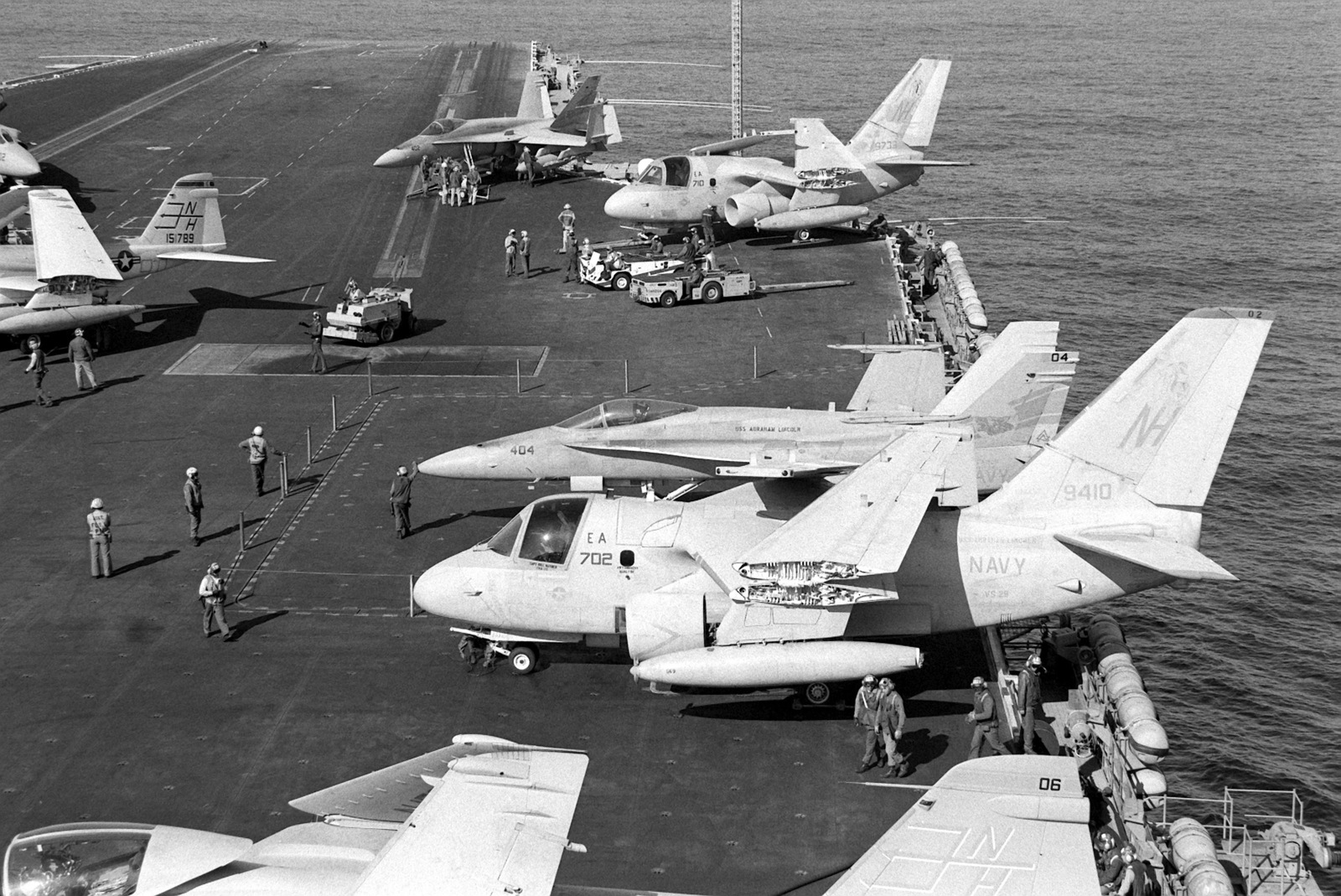 Various aircraft parked on the flight deck of the nuclear-powered aircraft carrier USS ABRAHAM LINCOLN (CVN-72) include Air Anti-submarine Squadron 29 (VS-29) S-3A Viking aircraft, Strike Fighter Squadron 305 (VFA-305) F/A-18 Hornet aircraft of the Naval Air Reserve, and Attack Squadron 95 (VA-95) A-6E Intruder aircraft