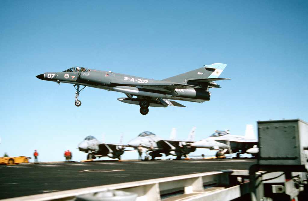 A Super Etendard aircraft of the Argentine navy comes in to briefly touch down on the flight deck of the nuclear-powered aircraft carrier USS ABRAHAM LINCOLN (CVN-72). The plane is taking part in touch-and-go landing aboard the LINCOLN during the vessel's circumnavigation of South America
