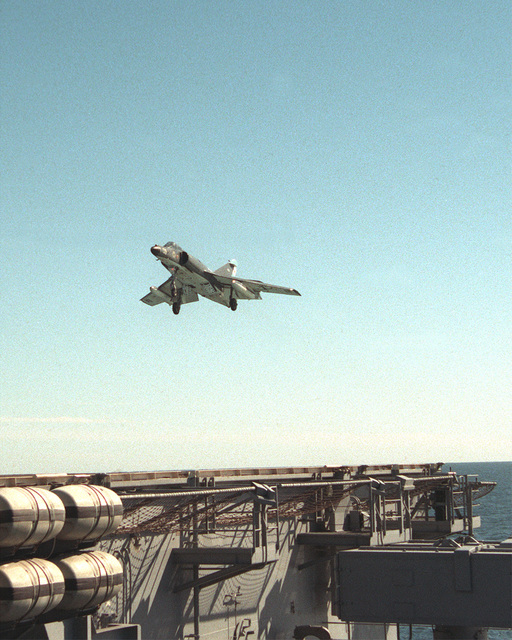 A Super Etendard aircraft of the Argentine navy approaches the flight deck of the nuclear-powered aircraft carrier USS ABRAHAM LINCOLN (CVN-72). The plane is taking part in tough-and-go landings aboard the LINCOLN during the vessel's circumnavigation of South America