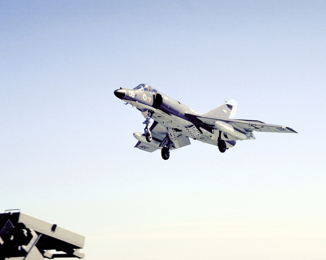 A Super Etendard aircraft of the Argentine Navy ascends after briefly touching down on the flight deck of the nuclear-powered aircraft carrier USS ABRAHAM LINCOLN (CVN-72). The plane is taking part in touch-and-go landings aboard the LINCOLN during the vessel's circumnavigation of South America