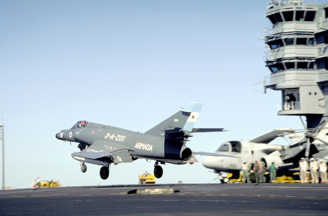 A Super Etendard aircraft of the Argentine Navy begins its ascent after briefly touching down on the flight deck of the nuclear-powered aircraft carrier USS ABRAHAM LINCOLN (CVN-72). The plane is taking part in touch-and-go landings aboard the LINCOLN during the vessel's circumnavigation of South America