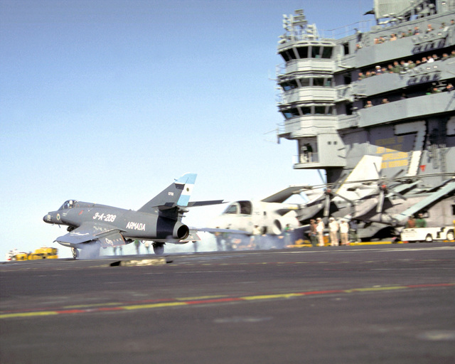 A Super Etendard aircraft of the Argentine Navy briefly touches down on flight deck of the nuclear-powered aircraft carrier USS ABRAHAM LINCOLN (CVN-72). The plane is taking part in touch-and-go landings aboard the LINCOLN during the vessel's circumnavigation of South America