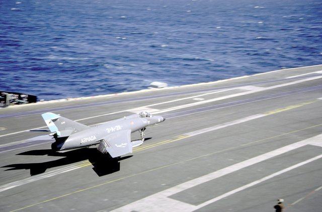 A Super Etendard aircraft of the Argentine Navy briefly touches down on the flight deck of the nuclear-powered aircraft carrier USS ABRAHAM LINCOLN (CVN-72). The plane is taking part in touch-and-go landings aboard the LINCOLN during the vessel's circumnavigation of South America