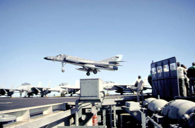A Super Etendard aircraft of the Argentine Navy comes in to briefly touch down on the flight deck of the nuclear-powered aircraft carrier USS ABRAHAM LINCOLN (CVN-72). The plane is taking part in touch-and-go landings aboard the LINCOLN during the vessel's circumnavigation of South America